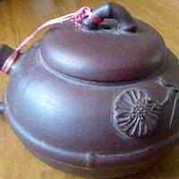 这个紫砂壶价值几何?是什么年代的?请教各位老师,谢谢!
