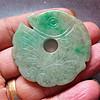 包浆厚重飘绿的清中期老翡翠鱼型玉璧
