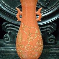 五代柴窑橘红釉官字款婴戏纹兽耳瓶